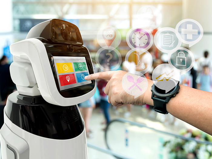 Hand with a tech watch with icons coming out pointing at a robot with buttons