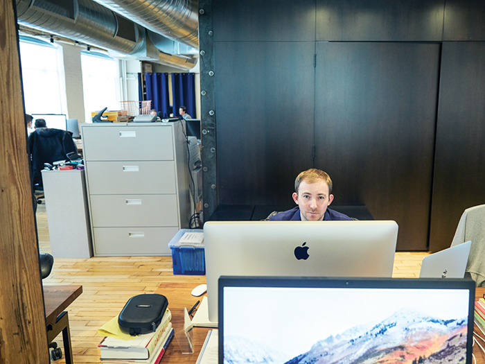 michael katchen sitting in front of his computer at wealthsimple office