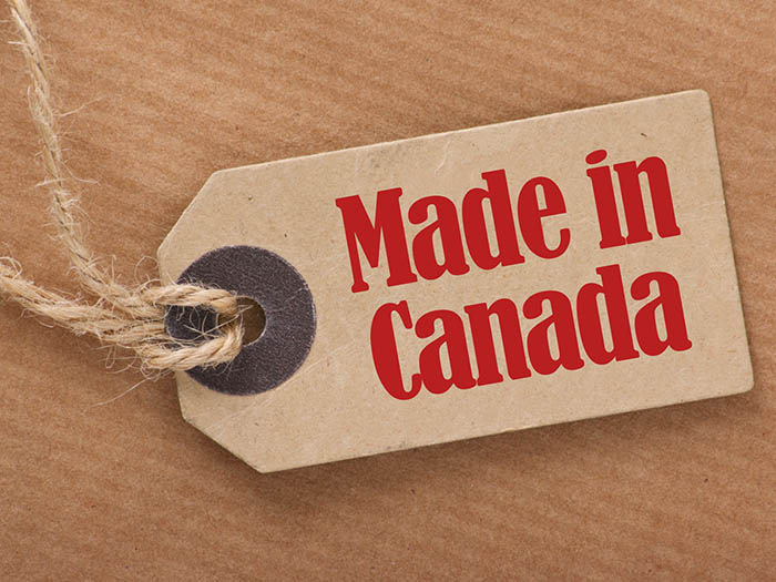 A brown paper price tag advising to people to 'Made in Canada'