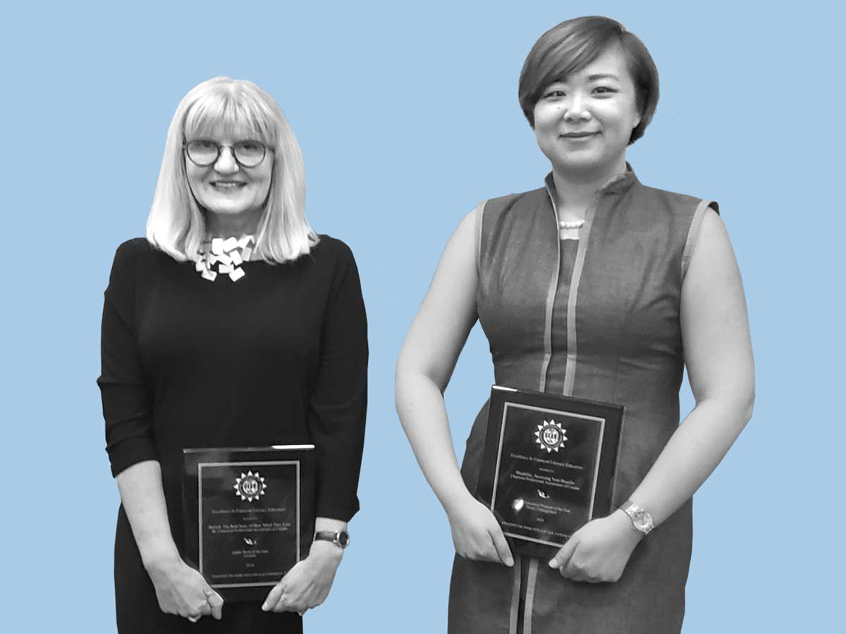 Doretta Thompson (right) and Li Zhang holding awards for the Financial Literacy program