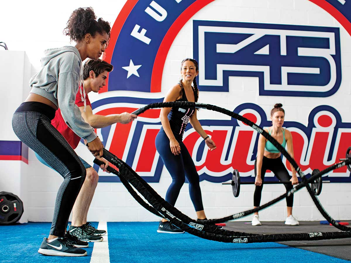 "Australian fitness upstart F45 and a client in a ultra-fast ""functional fitness"" classes."
