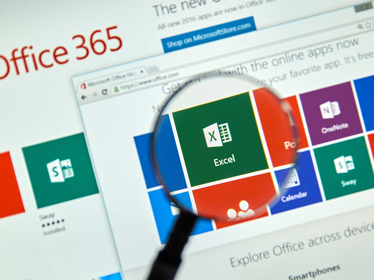 Magnifying glass in front of a Microsoft Office 365 Excel program icon on a computer screen
