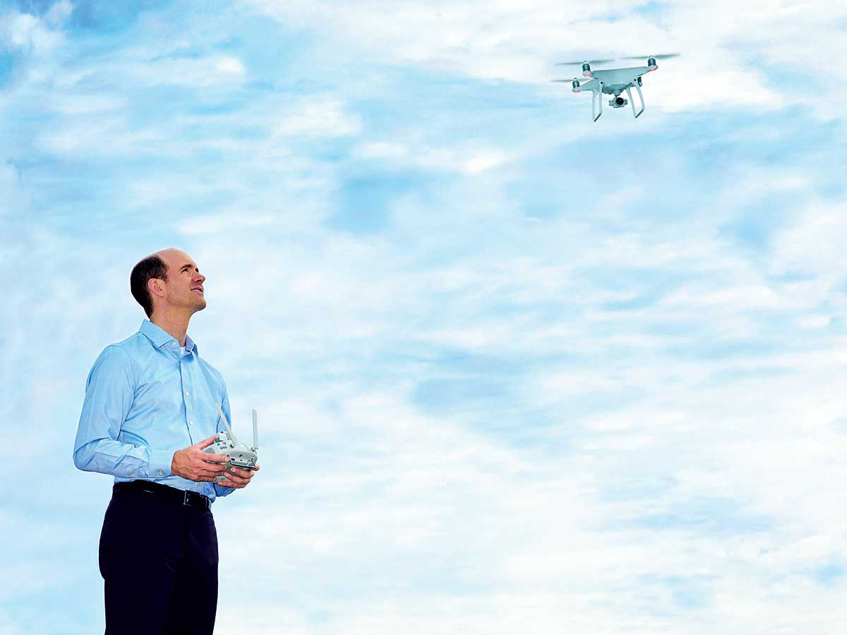 Andrew Morgan, a partner at EY, flying drone