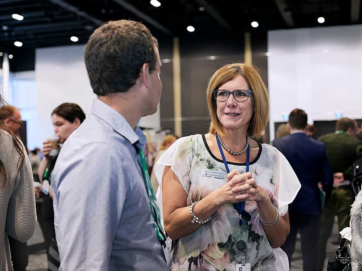 People networking and mingling at The ONE 2019 conference