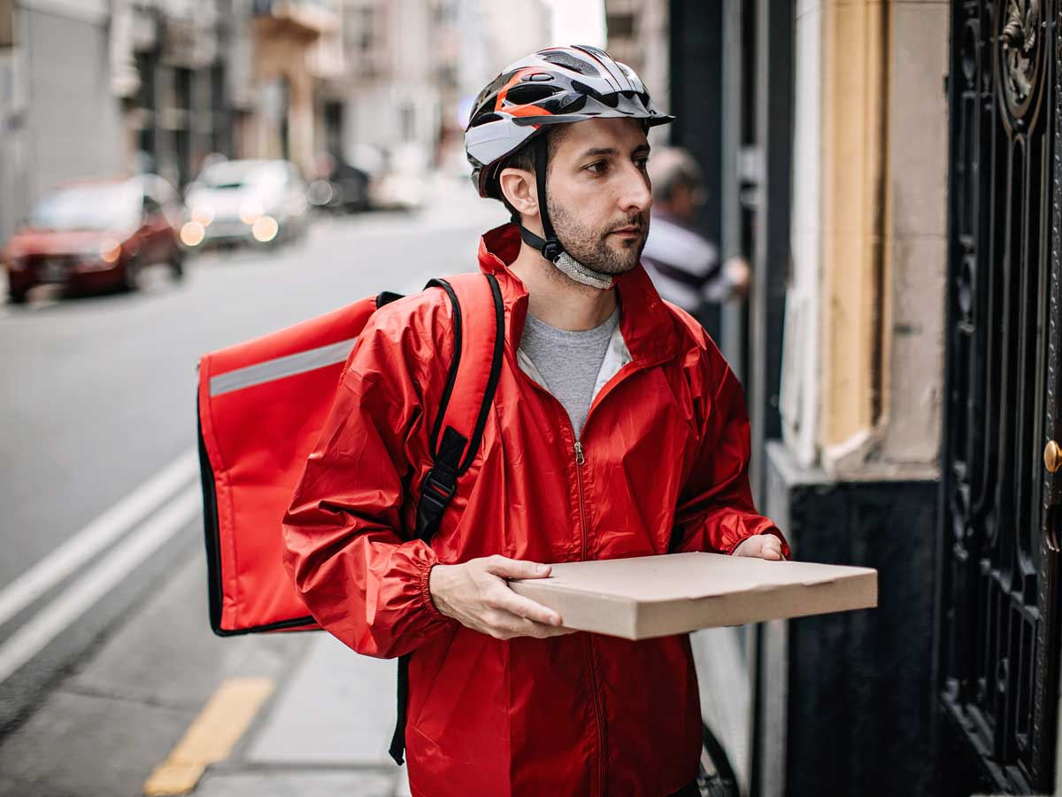 Man delivering food by bike in city