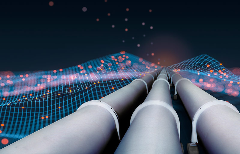 Pipelines along a digitized mountain landscape.