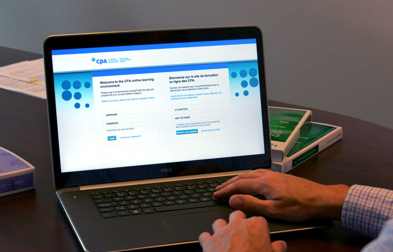 A close-up image of a business professional at his laptop logging into the CPA Canada Online Learning site.