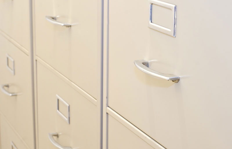 A close-up of closed file drawers.