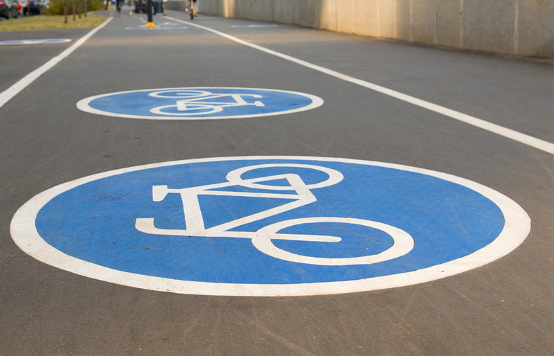 Close up of cycling symbol on city paved bike path