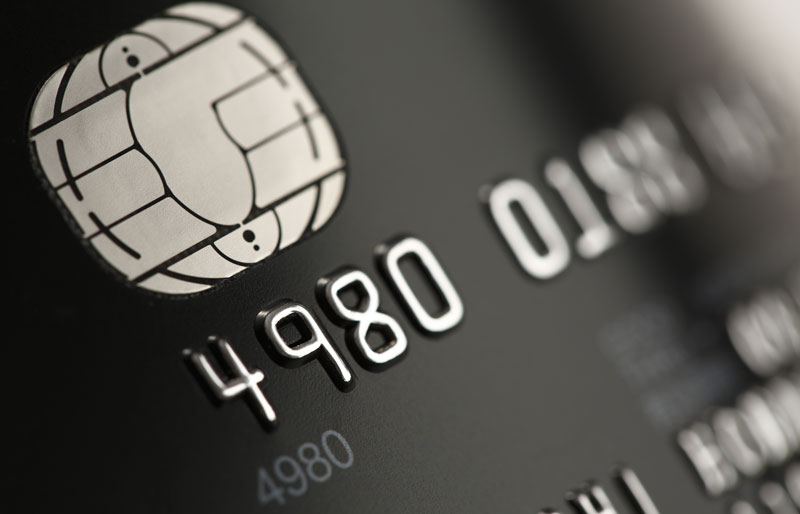 Close up of generic credit card with its chip and numbers in view