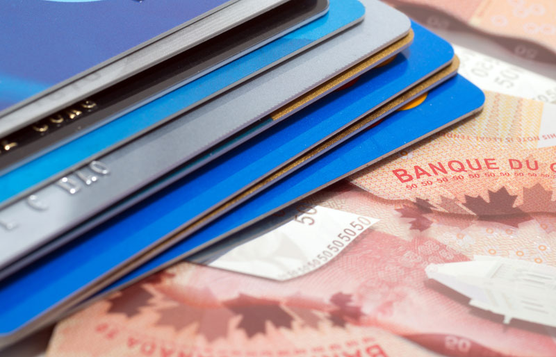 Close up of credit cards and Canadian money