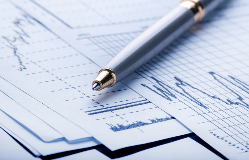 Pen sitting on chart of financials
