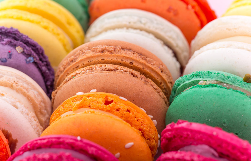 Close up of various colourful macaroons in bakery
