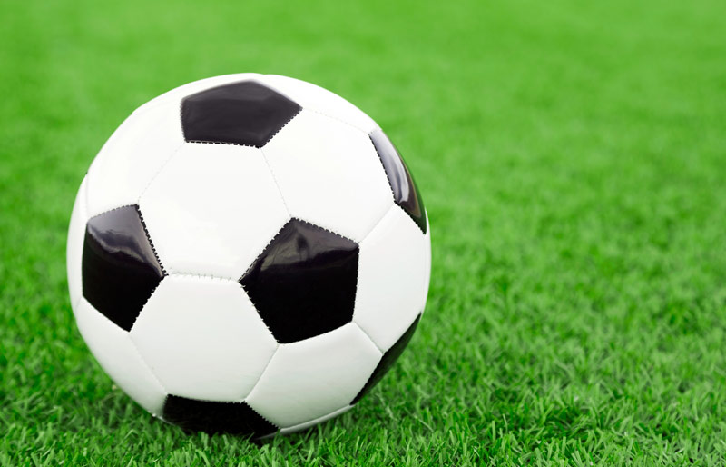 Close up of soccer ball on synthetic grass field