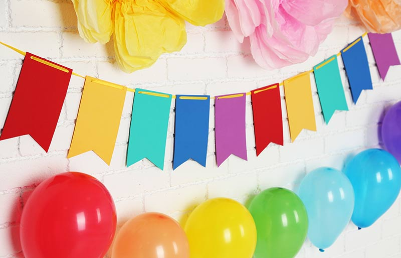 rainbow assortment of balloons and banners