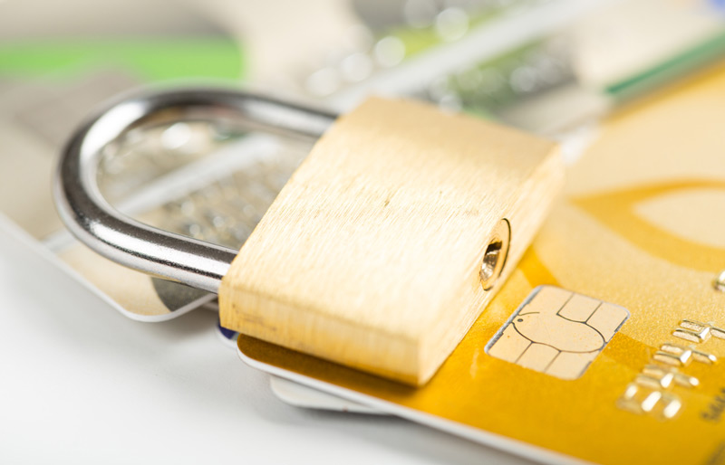 A padlock on top of credit cards.
