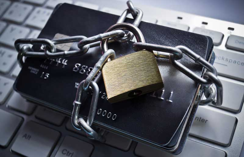 Chained credit cards on keyboard