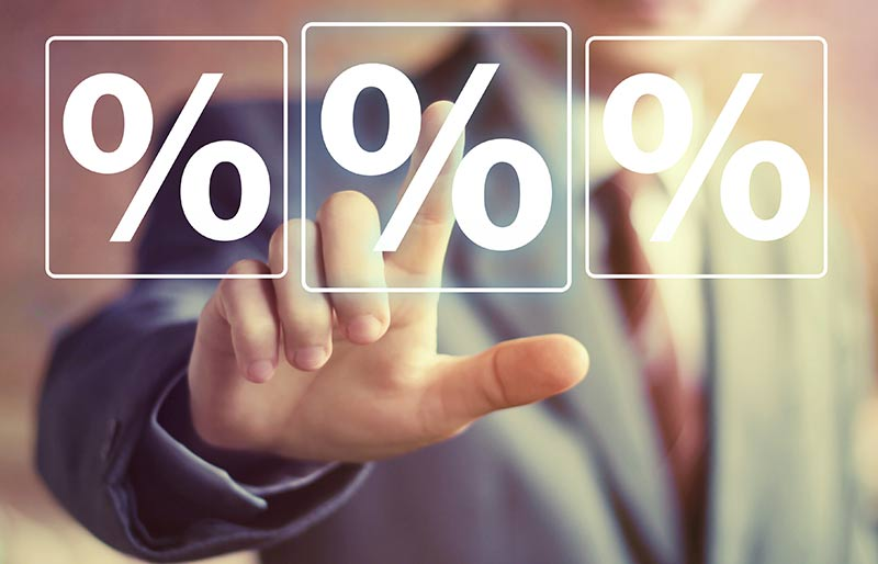 A businessman pointing at percentages.