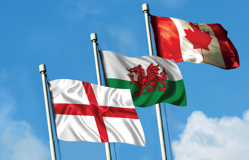Flags of both England and Wales waving together with the Canadian flag
