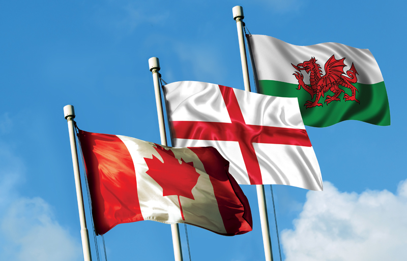 Canadian flag waving together with the flags of both England and Wales