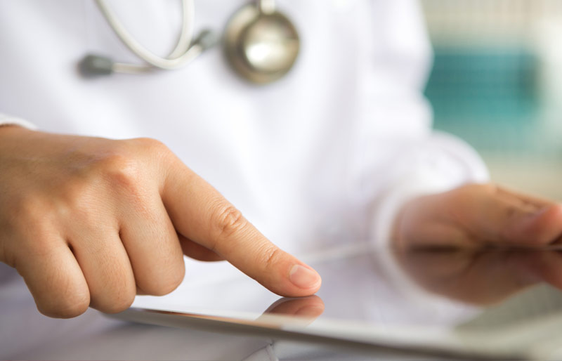Health professional using tablet device