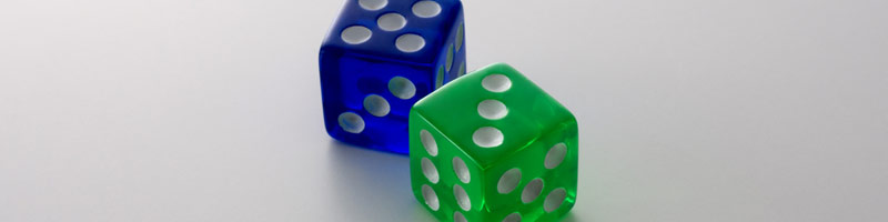 A close-up of two dice, a blue five and a green three.