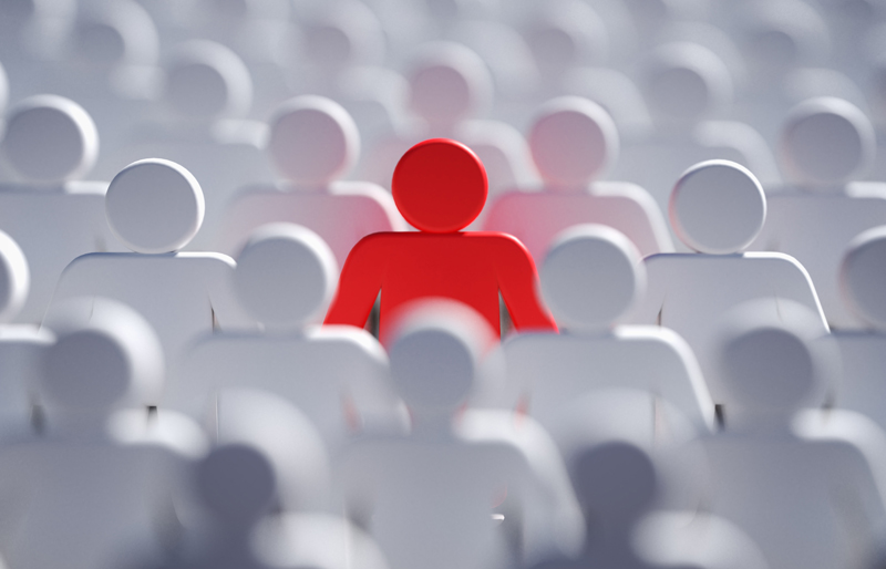 Red icon-shaped person among multiple rows  of white icon-shaped people