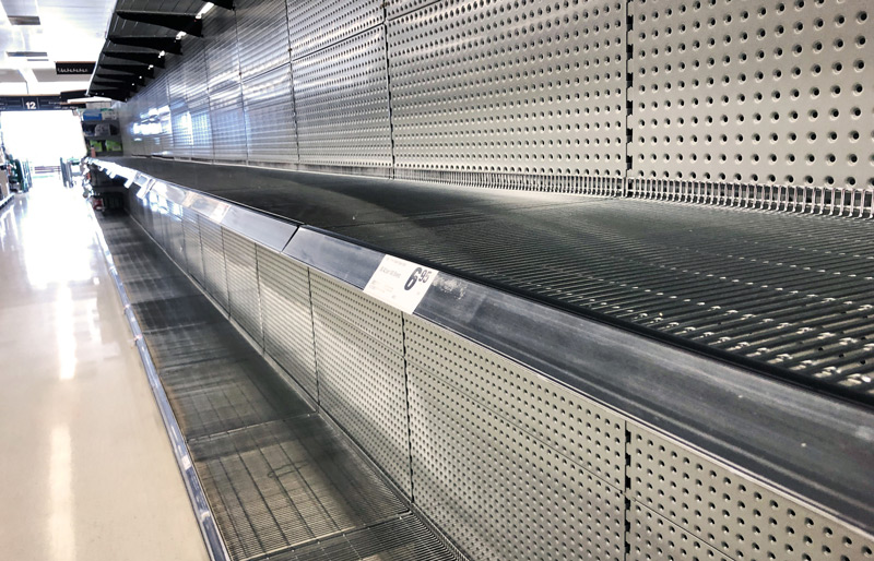 Empty rows of shelves in a retail store.