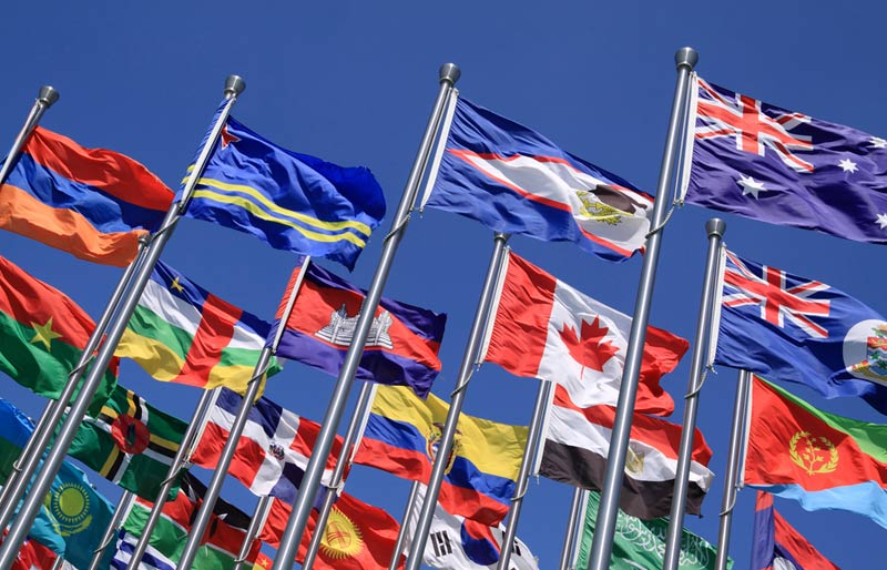 The national flag is flying grouped with other flags of the world.