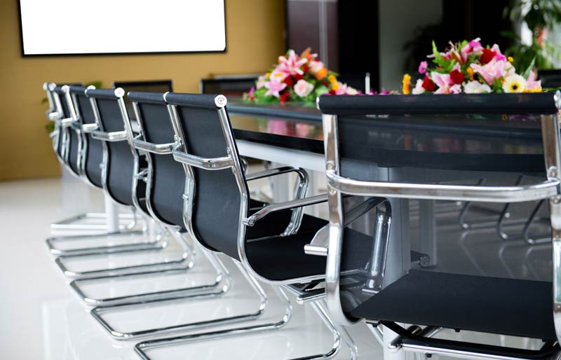 A close-up of a boardroom.
