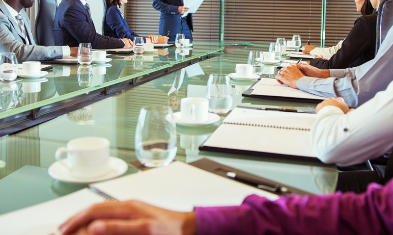 A cropped image of a neatly arranged boardroom.