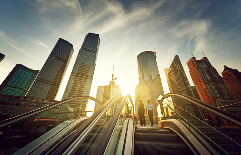 An escalator in Shanghai Lujiazui Financial District, China during sunset.