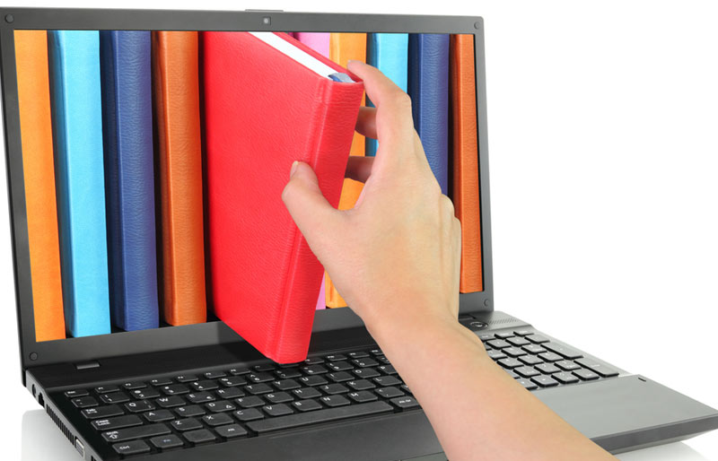 Person pulling book out through computer screen