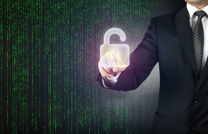 An image of a business professional pointing to a ghost image of a padlock with the Matrix data streaming down in front.