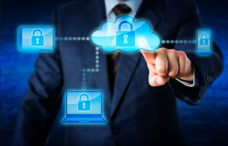 A stylized image of a business professional pointing to a cloud with a padlock that connects to a laptop, mobile phone and tablet.