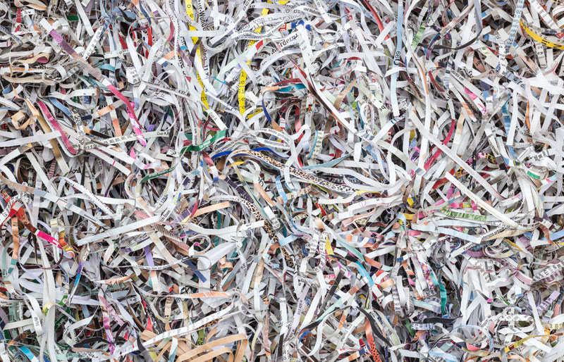 A close-up cropped image of shredded paper records.
