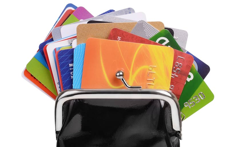 An image of a change purse with numerous loyalty cards showing.