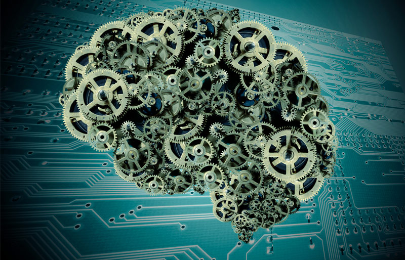 This is a concept image of a brain made from gears with a computer motherboard as a background.