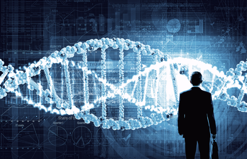 DNA on screen with man looking up