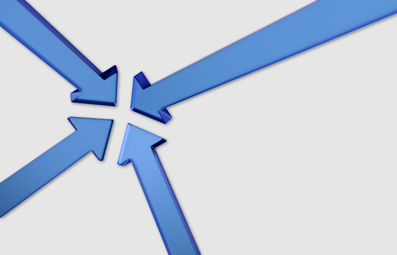 A conceptual image of four blue translucent arrows all converging or coming together at their points.