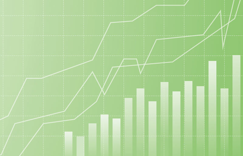 Business chart with a bar and a linear graph on a green and grid background.