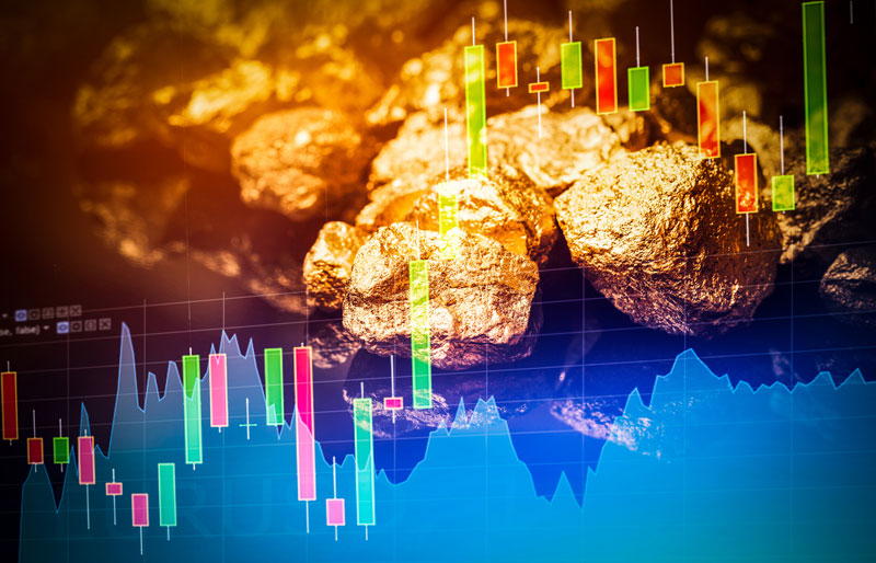 digital stocks overlay with gold nuggets in background