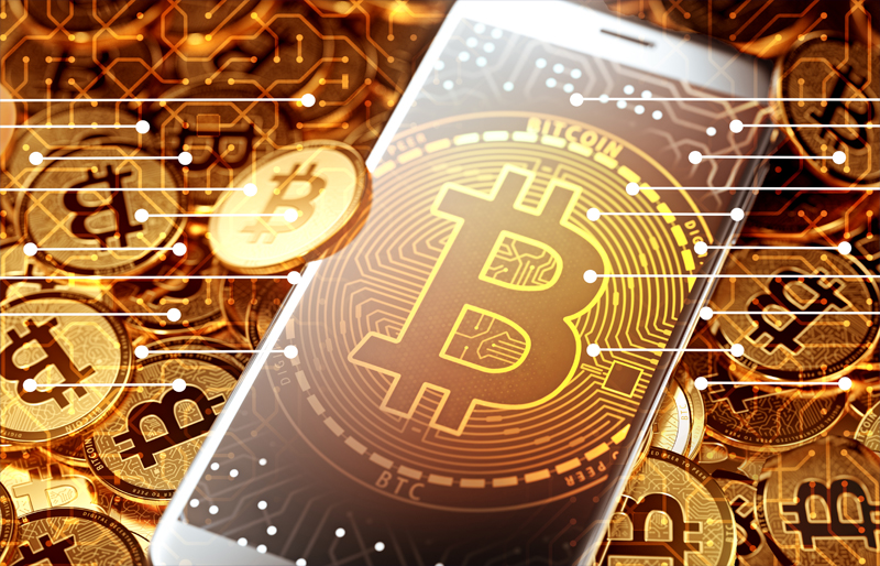 Bitcoin logo on iphone sitting among pile of Bitcoins, with digital circuits overlaid