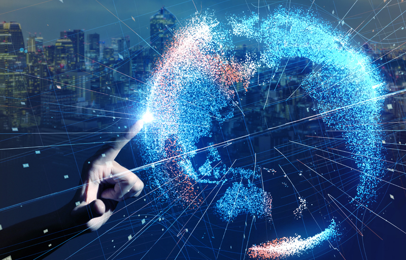 finger touching virtual global, made up of dots of light