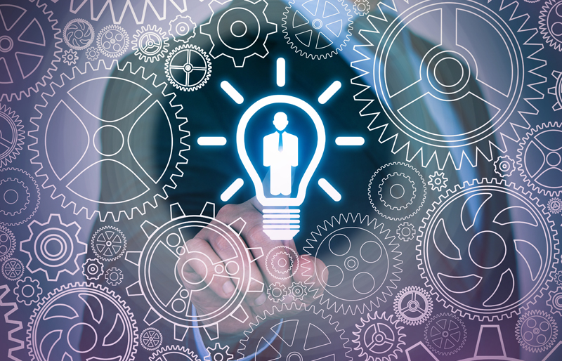 Business person touching a lightbulb icon in center, surrounded by virtual gears interlocked