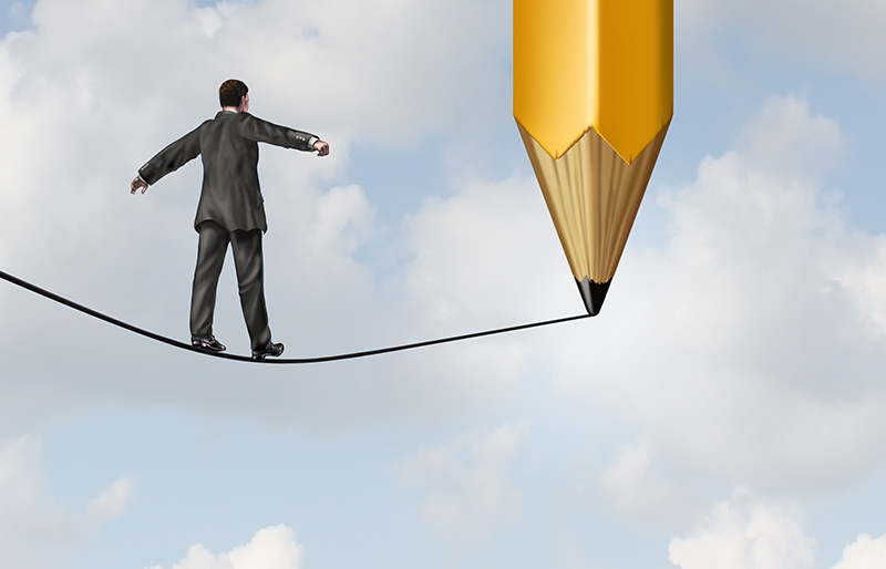 Illustration of a business person walking a tightrope, still being drawn by a large pencil