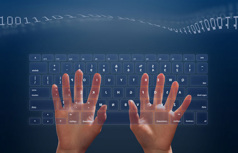 Hands on a transparent computer keyboard with binary code floating above on blue background.