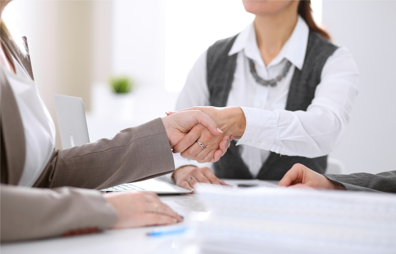 Business woman and client shaking hands