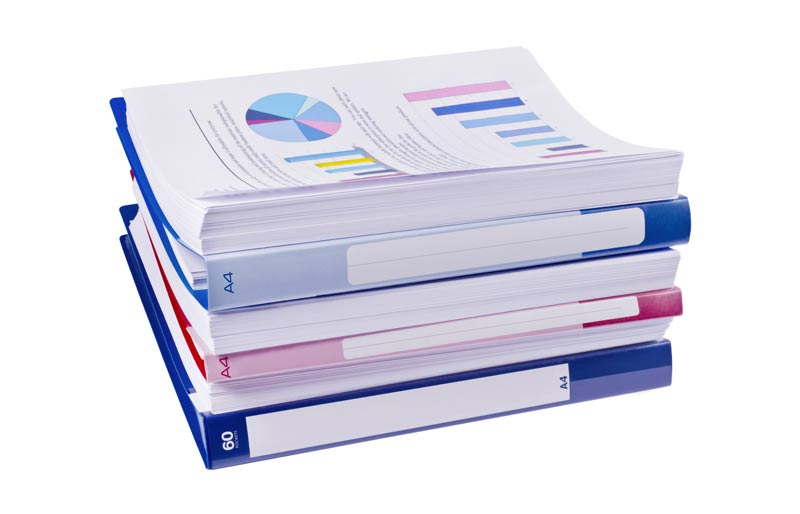 a pile of financial reports on a white background