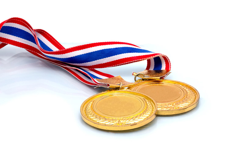 A close-up image of two gold medals.